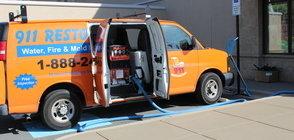 Water Damage Restoration Van At Exterior Of Job Location