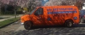 Water Damage and Mold Removal Van On Route To Residential Job Site