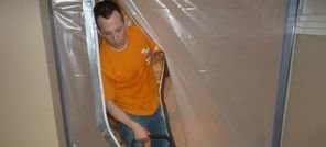 Mold Inspection Technician Using Air Mover Near Vapor Barrier