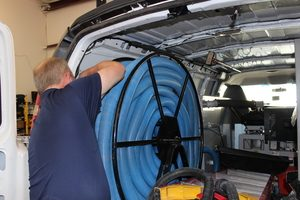 water-damage-restoration-technician-prepping-suction-hoses